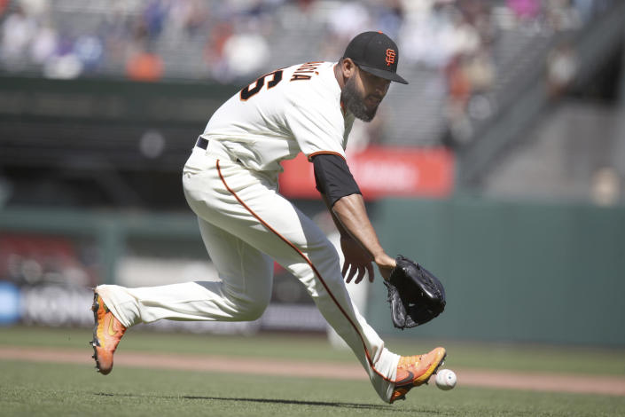 San Francisco Giants' Jarlin Garcia (66) fields a ground ball and forces out Chicago Cubs' Jason Heyward in the eighth inning of a baseball game Sunday, June 6, 2021, in San Francisco. (AP Photo/Scot Tucker)