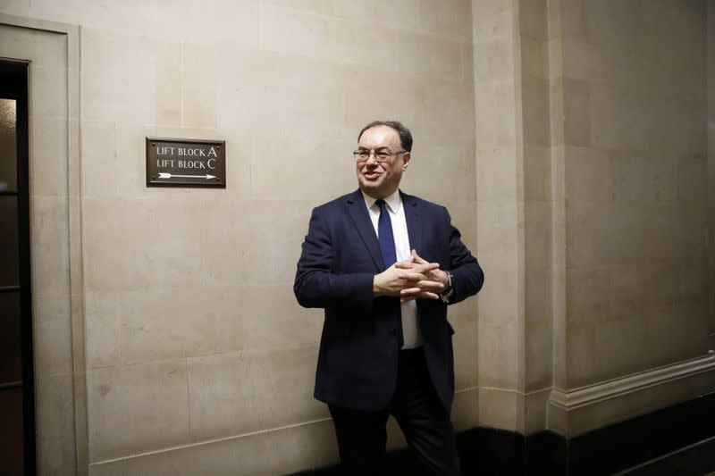 Bank of England Governor Andrew Bailey poses for a photograph on the first day of his new role at the Central Bank in London