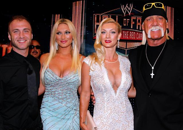 IMAGE DISTRIBUTED FOR WWE - Hulk Hogan, right, Jennifer McDaniels, second right, Brooke Hogan, second from left, and Nick Hogan, left, are seen at the WWE Hall of Fame Induction at the Smoothie King Center in New Orleans on Saturday, April 5, 2014. (Jonathan Bachman/AP Images for WWE)