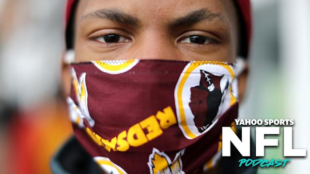 """A <a class=""""link rapid-noclick-resp"""" href=""""/nfl/teams/washington/"""" data-ylk=""""slk:Washington Redskins"""">Washington Redskins</a> fan wears a mask in public amid the thread of COVID-19. Has the NFL's public stances in response to Coronavirus been tone-deaf? Charles Robinson & Terez Paylor discuss on the latest Yahoo Sports NFL Podcast. (Photo by Chip Somodevilla/Getty Images)"""