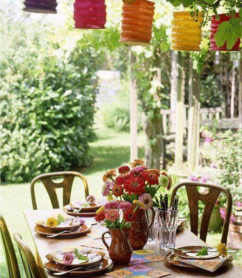 <p>For a pulled-together look, pair inexpensive paper lanterns with backyard flowers like zinnias in pinks, reds, oranges and yellows. Save some stems for a sweet touch at each place setting.<br></p>