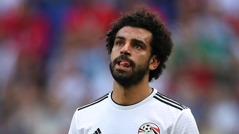Salah returns to Liverpool with injury