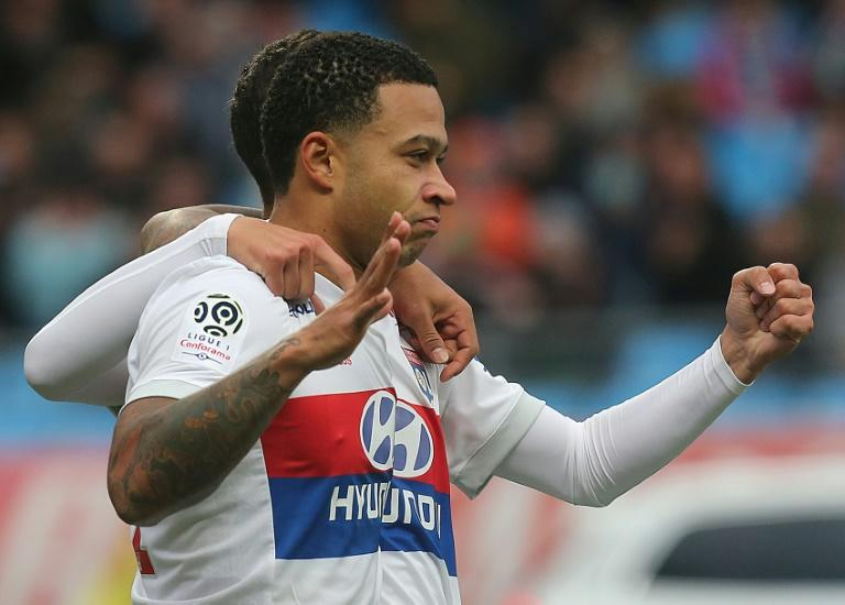Lyon's forward Memphis Depay celebrates after scoring during the Ligue 1 football match against Troyes at The Aube Stadium in Troyes on October 22, 2017