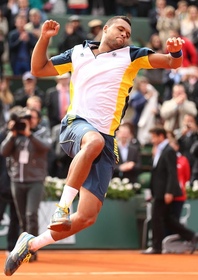PARIS, FRANCE - MAY 31: Jo-Wilfried Tsonga of France celebrates match point in his Men's Singles match against Jeremy Chardy of France during day six of the French Open at Roland Garros on May 31, 2013 in Paris, France. (Photo by Matthew Stockman/Getty Images)