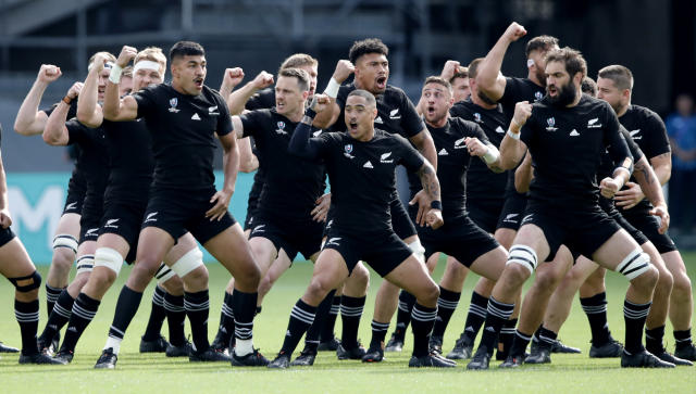 The All Blacks perform the haka ahead of the Rugby World Cup Pool B game at Tokyo Stadium between New Zealand and Namibia in Tokyo, Japan, Sunday, Oct. 6, 2019. (AP Photo/Christophe Ena)