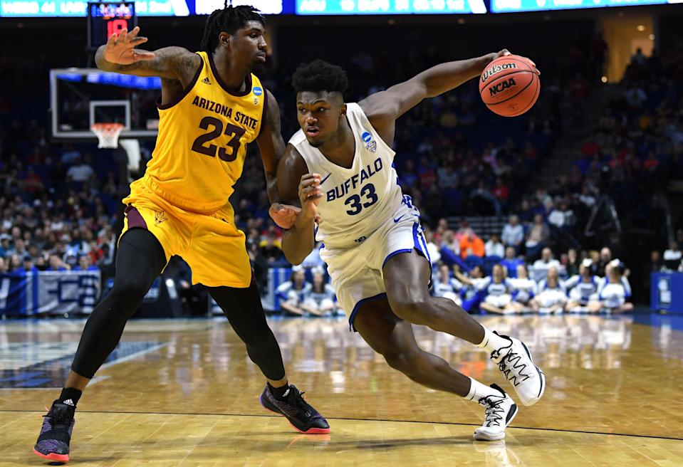 <p>Nick Perkins #33 of the Buffalo Bulls drives on Romello White #23 of the Arizona State Sun Devils during the first half of the first round game of the 2019 NCAA Men's Basketball Tournament at BOK Center on March 22, 2019 in Tulsa, Oklahoma. </p>