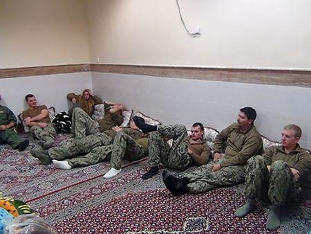 An undated picture released by Iran's Revolutionary Guards website shows American sailors sitting in a unknown place in Iran. REUTERS/sepahnews.ir/TIMA/Handout via Reuters