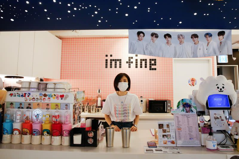 Cafe owner Kim Eun-hee, fan of K-pop boy band BTS, speaks to Reuters during an interview in her cafe in Seoul