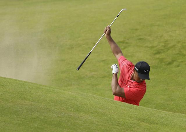 Tiger Woods of the United States reacts after failing to hit the ball out of the bunker on the sixth hole at Royal Lytham & St Annes golf club during the final round of the British Open Golf Championship, Lytham St Annes, England Sunday, July 22, 2012. (AP Photo/Peter Morrison)