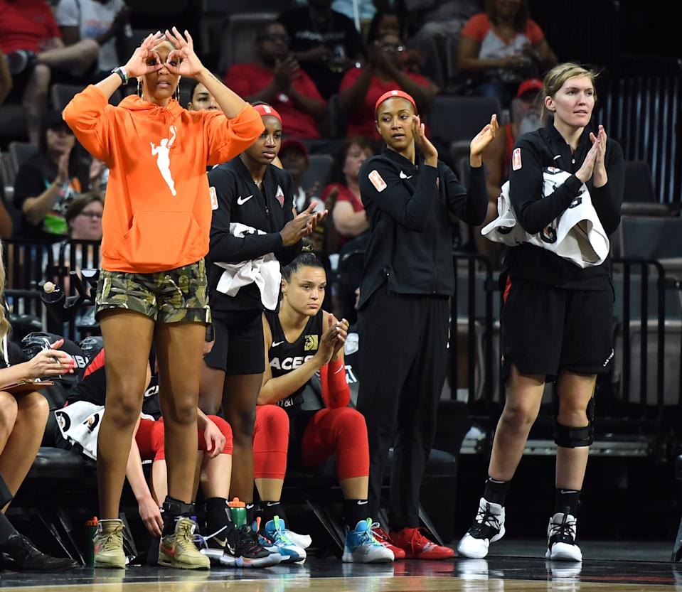 A'ja Wilson, Jackie Young, Kayla McBride, Jaime Nared and Carolyn Swords react on the bench after teammate Sugar Rodgers (not pictured) hit a 3-pointer.