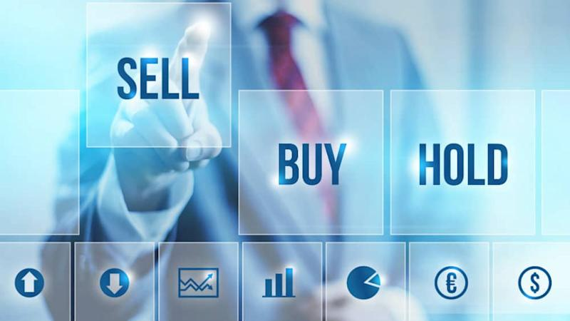 Businessman selecting a Sell symbol