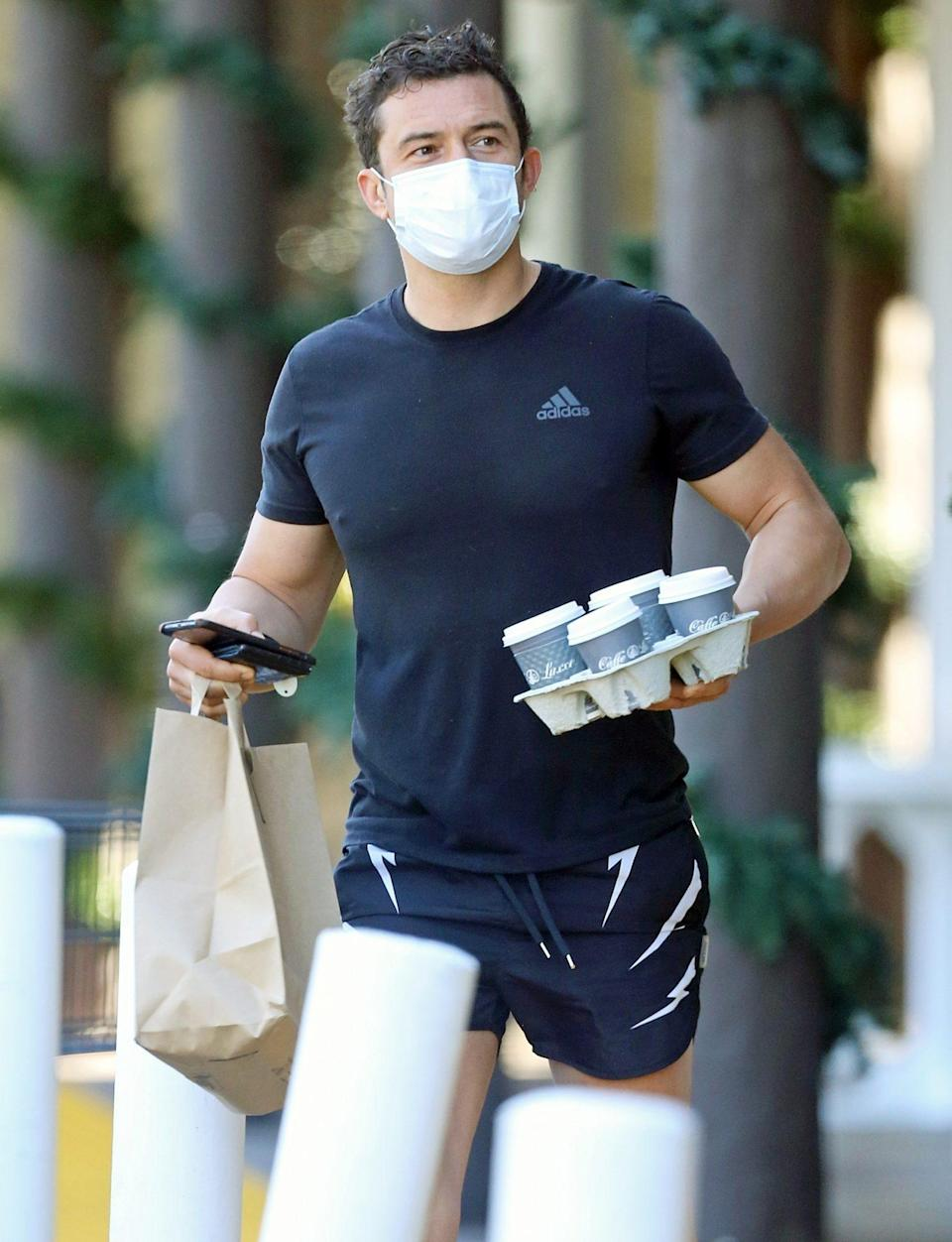 <p>Orlando Bloom was out and about in Montecito, California on Sunday, running errands and picking up coffee while wearing a mask.</p>