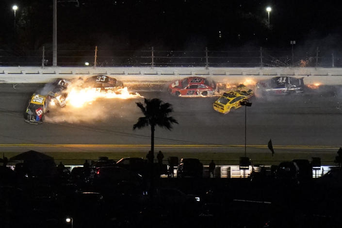 Racers crash during the last lap in the NASCAR Daytona 500 auto race at Daytona International Speedway, Monday, Feb. 15, 2021, in Daytona Beach, Fla. Joey Logano (22) was leading before the wreck; Brad Keselowski (2) was in second. (AP Photo/Chris O'Meara)