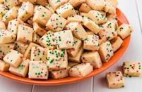 """<p>These <a href=""""https://www.delish.com/uk/cooking/recipes/a28976808/shortbread-cookie-recipe/"""" rel=""""nofollow noopener"""" target=""""_blank"""" data-ylk=""""slk:shortbread"""" class=""""link rapid-noclick-resp"""">shortbread</a> bites are our favourite way to Christmas. They're even easier to pull together than <a href=""""https://www.delish.com/uk/cooking/recipes/a29640305/basic-sugar-cookies-recipe/"""" rel=""""nofollow noopener"""" target=""""_blank"""" data-ylk=""""slk:sugar cookies"""" class=""""link rapid-noclick-resp"""">sugar cookies</a>...but way more addicting.</p><p>Get the <a href=""""https://www.delish.com/uk/cooking/recipes/a32062881/shortbread-bites-recipe/"""" rel=""""nofollow noopener"""" target=""""_blank"""" data-ylk=""""slk:Shortbread Bites"""" class=""""link rapid-noclick-resp"""">Shortbread Bites</a> recipe.</p>"""