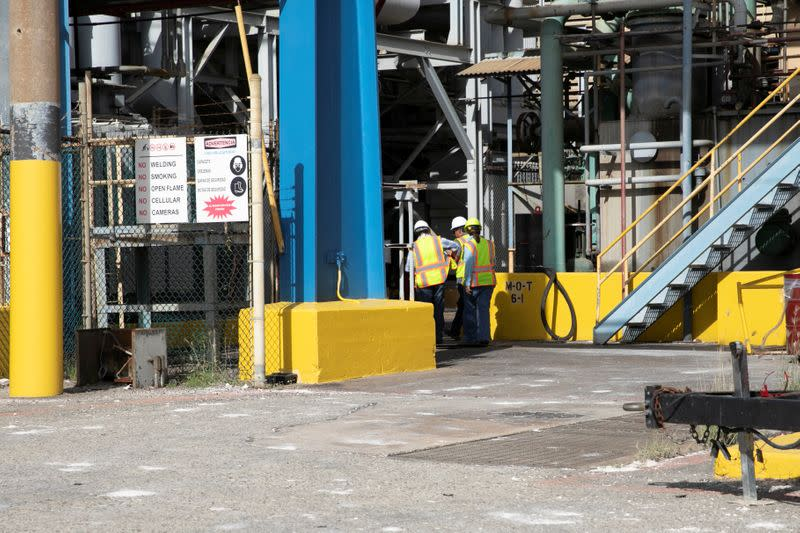 Workers are seen at the Costa Sur power plant after an earthquake in Guayanilla