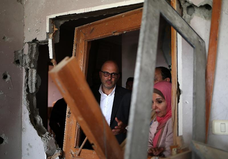 Robert Piper, UN deputy special coordinator for the Middle East peace process as well as humanitarian coordinator for the Palestinian territories, visits the damaged building of an NGO working with disabled children (AFP Photo/Mohammed Abed)