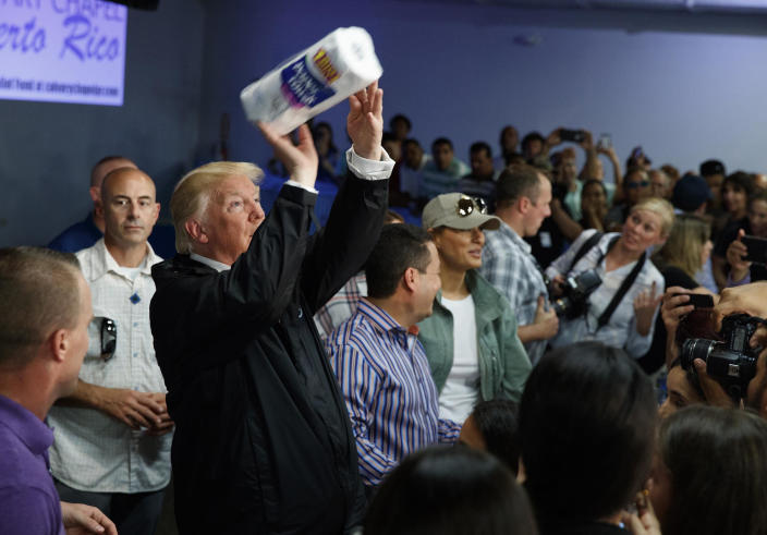 President Trump tosses paper towels into a crowd in Guaynabo, Puerto Rico, on Oct. 3, 2017, after Hurricane Maria devastated the region. (Evan Vucci/AP Photo)