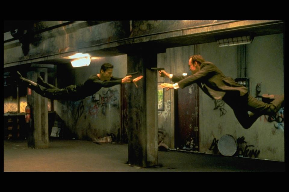 Keanu Reeves and Hugo Weaving face each other in a scene from Andy and Larry Wachowski's 1999 movie The Matrix. In this scene, Neo (Reeves) fights the computerized Agent Smith (Weaving). (Photo by Siemoneit/Sygma via Getty Images)