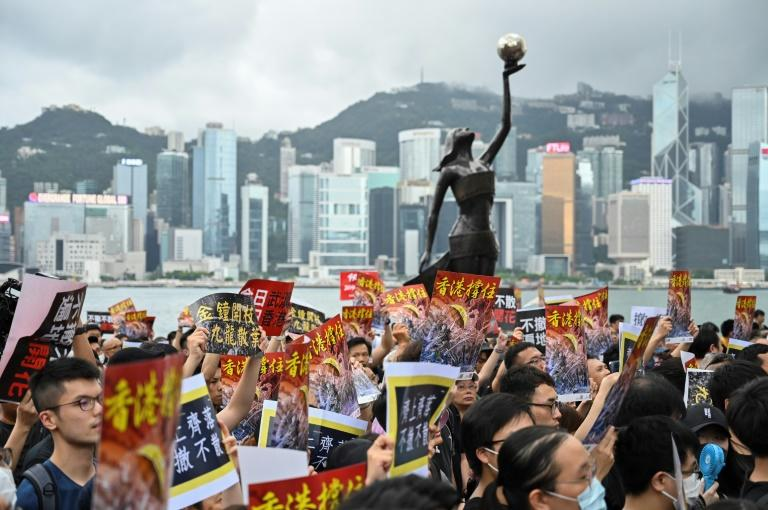 Inside Hong Kong, mainland Chinese are afforded the same free speech protections as any other inhabitant, but they risk censure or punishment on return to the mainland (AFP Photo/Hector RETAMAL)
