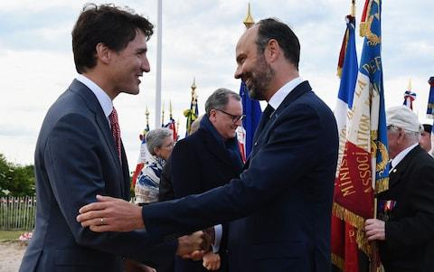 French Prime Minister Edouard Philippe (R) shakes hands with Canadian Prime Minister Justin Trudeau - Credit: FRED TANNEAU/POOL/EPA-EFE/REX