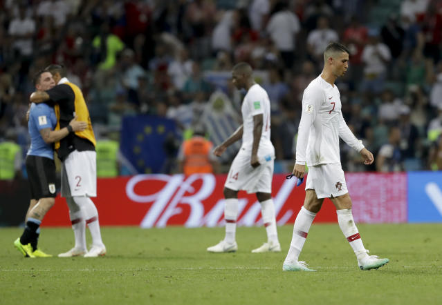 Portugal's Cristiano Ronaldo, right, leaves the field after the round of 16 match between Uruguay and Portugal at the 2018 soccer World Cup at the Fisht Stadium in Sochi, Russia, Saturday, June 30, 2018. (AP Photo/Andre Penner)