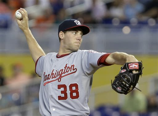 Washington Nationals' Taylor Jordan delivers a pitch during the first inning of a baseball game against the Miami Marlins, Sunday, July 14, 2013, in Miami. (AP Photo/Wilfredo Lee)