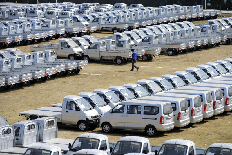 In this photo taken Wednesday April 16, 2014, vehicles are parked outside a factory of SGMW, a joint venture between Chinese carmakers and General Motors in Qingdao in east China's Shandong province. China's automakers are the underdogs heading into next week's Beijing auto show, where foreign and domestic brands will jostle for attention in a crowded market. Facing intense competition from General Motors, Volkswagen and other global rivals, local brands such as Chery, Geely and SUV maker Great Wall have seen sales and market share shrink this year while China's overall market grew. (AP Photo) CHINA OUT