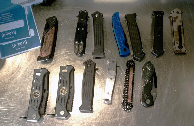 In this July 7, 2011 photo released by the Transportation Security Administration knives are shown that were discovered being carried on a passenger during a screening at Thurgood Marshall Baltimore-Washington International Airport in Linthicum, Md.  TSA officers say they found 13 knives, including a switchblade and a butterfly knife, inside a man's carry-on luggage. Transportation Security Administration officers say they found 13 knives, including a switchblade and a butterfly knife, inside a man's carry-on luggage at a Washington-area airport. TSA spokesman Kawika Riley says an officer operating an X-ray machine last week at Thurgood Marshall Baltimore-Washington International Airport noticed something suspicious in the man's luggage. Sgt. Kirk Perez, a Maryland Transportation Authority Police spokesman, says 25-year-old Amr Gamal Shedid of Baltimore had been trying to board a flight to Minnesota. (AP Photo/Transportation Security Administration)