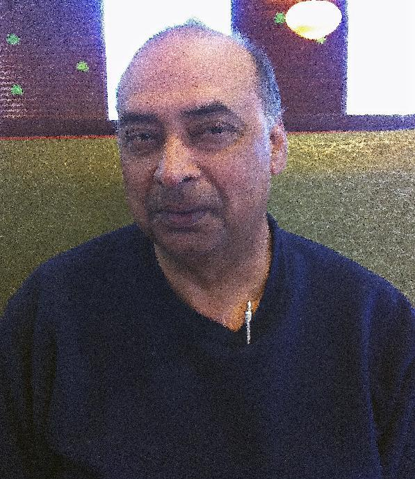 David Mahmood Siddiqui poses for a photo, Friday, March 8, 2013, near Plantation, Fla. Siddiqui described his four years of undercover FBI informant work in helping convict Muslim cleric Hafiz Khan of financially supporting the  Pakistani Taliban. (AP Photo/Curt Anderson)