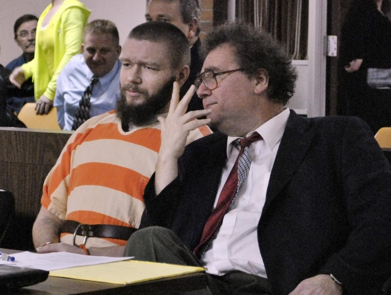 Kyle Flack, left, of Ottawa, Kan., sits with his court-appointed lawyer, Ronald Evans, head of the Kansas Death Penalty Defense Unit in Topeka, during a hearing in Franklin County District Court Tuesday, March 11, 2014, in Ottawa, Kan. Flack, 28, is charged with capital murder and other charges in the slaying of four people, including an 18-month-old girl, at a farm in rural eastern Kansas last spring. (AP Photo/The Ottawa Herald, Abby Eckel, Pool)