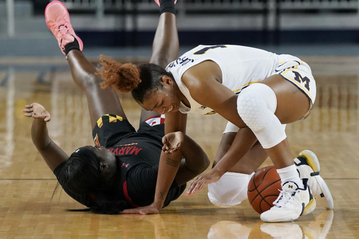 Michigan guard Akienreh Johnson (14) and Maryland guard Ashley Owusu battle for a loose ball during the first half of an NCAA college basketball game, Thursday, March 4, 2021, in Ann Arbor, Mich. (AP Photo/Carlos Osorio)