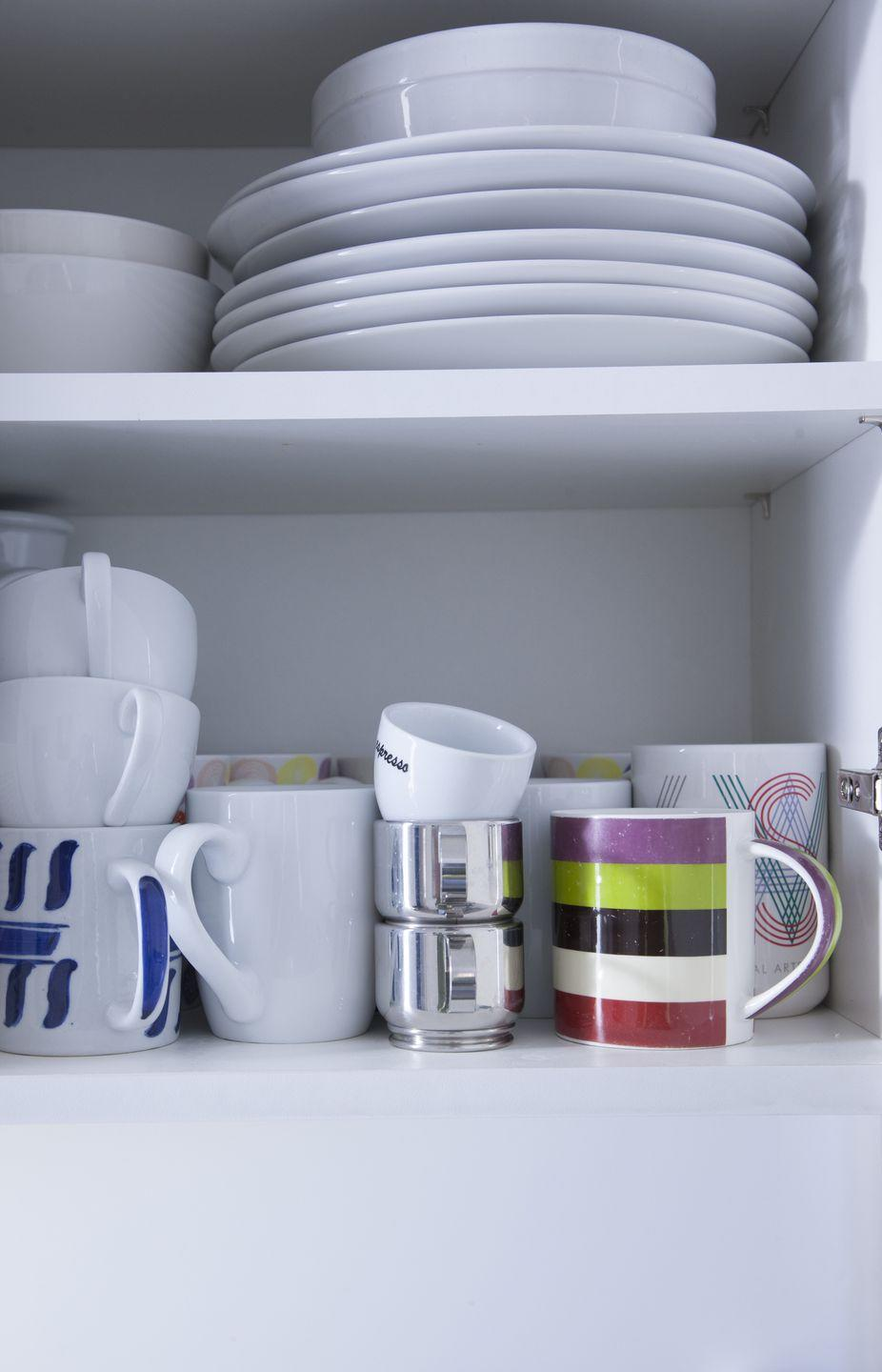 """<p>These are always given as gifts, so it's likely that you have more than there are people in your home. Keep your favorites and donate the rest. Once you pare down, here are a few ways to <a href=""""https://www.goodhousekeeping.com/home/organizing/g3497/how-to-organize-coffee-cups/ """" rel=""""nofollow noopener"""" target=""""_blank"""" data-ylk=""""slk:keep your collection organized"""" class=""""link rapid-noclick-resp"""">keep your collection organized</a>.</p>"""