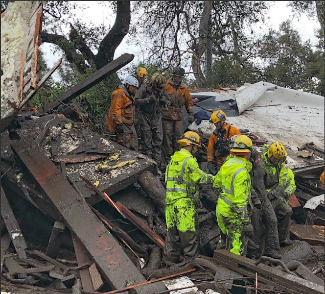 Californian firefighters successfully rescued a 14 yr old girl on January 9 after she was trapped for hours inside a destroyed home in Montecito (AFP Photo/Mike ELIASON)