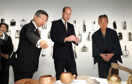Britain's Prince William talks with Motoyuki Tamagawa, Head of Copperwear Workshop, at the official opening of Japan House in London, Britain, September 13, 2018. Tim P. Whitby/Pool via REUTERS
