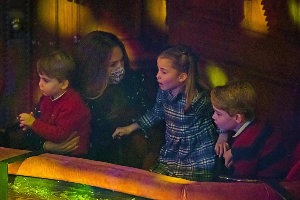 Britain's Catherine, Duchess of Cambridge (2nd L) holds Britain's Prince Louis of Cambridge (L) as she speaks with Britain's Princess Charlotte of Cambridge (2nd R) and Britain's Prince George of Cambridge (R) at a special pantomime performance of The National Lotterys Pantoland  at London's Palladium Theatre in London on December 11, 2020, to thank key workers and their families for their efforts throughout the pandemic. (Photo by Aaron Chown / POOL / AFP) (Photo by AARON CHOWN/POOL/AFP via Getty Images)