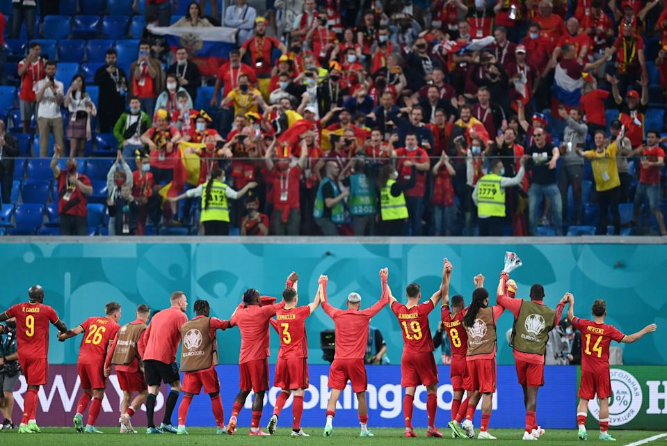 Belgium's players celebrate with their fans after a 3-0 win over Russia (AP)