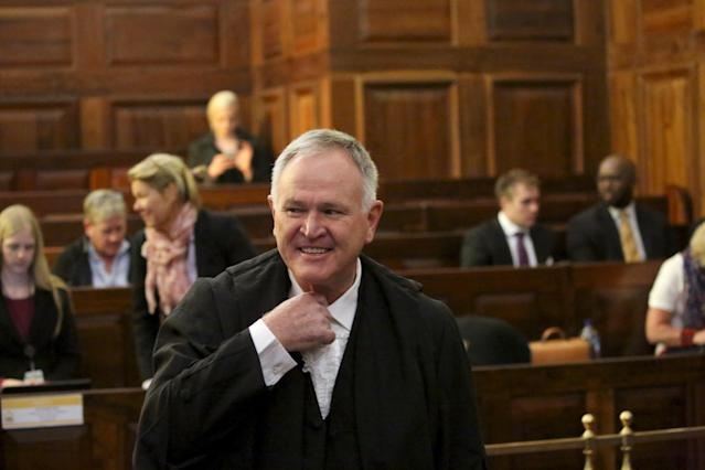 Defence lawyer Barry Roux gestures before an appeal by state prosecutors against South African paralympian Oscar Pistorius's conviction last year at the Supreme Court of Appeal (SCA) in Bloemfontein, November 3, 2015. Pistorius, freed on parole last month after serving a fifth of his prison term for killing his girlfriend, faces years more in jail if state lawyers can get his conviction scaled up to murder from culpable homicide. Prosecutors will argue before the Supreme Court that a high court judge was wrong to let Pistorius off the more serious charge after he fired four shots through a door on Valentine's Day 2013, killing Reeva Steenkamp. REUTERS/Siphiwe Sibeko