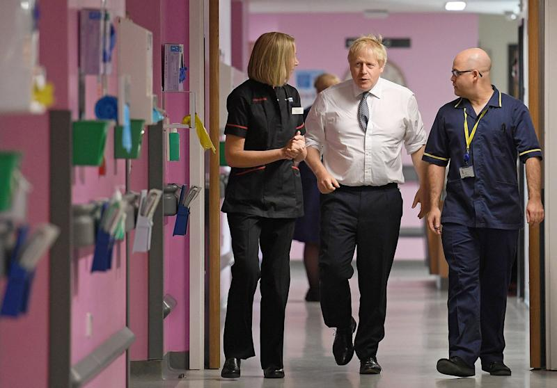 Johnson Pledges Not to Sell Out the NHS to Trump: U.K. Votes