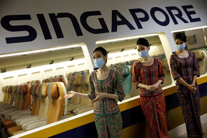 FILE PHOTO: Cabin crew speak to participants during a guided tour at the Singapore Airlines Training Centre in Singapore