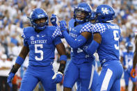 Kentucky linebacker DeAndre Square (5) celebrates after making a tackle during the first half of an NCAA college football game against Florida in Lexington, Ky., Saturday, Oct. 2, 2021. (AP Photo/Michael Clubb)