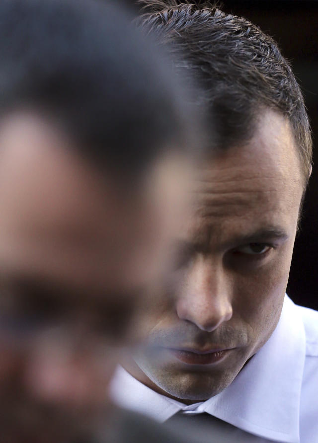 Oscar Pistorius arrives at the high court in Pretoria, South Africa, Friday, April 11, 2014. The chief prosecutor laughed scornfully at an answer from Pistorius during the Olympic athlete's murder trial Thursday, mocking the man who shot his girlfriend. Pistorius is charged with murder for the shooting death of his girlfriend, Reeva Steenkamp, on Valentines Day in 2013. (AP Photo/Themba Hadebe)