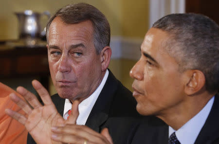 Speaker of the House John Boehner listens as U.S. President Barack Obama hosts a luncheon for bi-partisan Congressional leaders in the Old Family Dining Room at the White House in Washington, November 7, 2014. REUTERS/Larry Downing