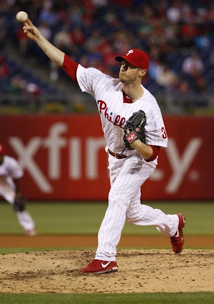 Philadelphia Phillies' starting pitcher Kyle Kendrick pitches during the fourth inning of a baseball game against the Cincinnati Reds, Friday, May 16, 2014, in Philadelphia. (AP Photo/Chris Szagola)