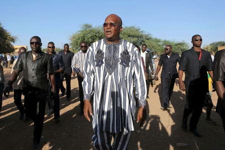 Kabore arrives to vote during the presidential and legislative election at a polling station in Ouagadougou