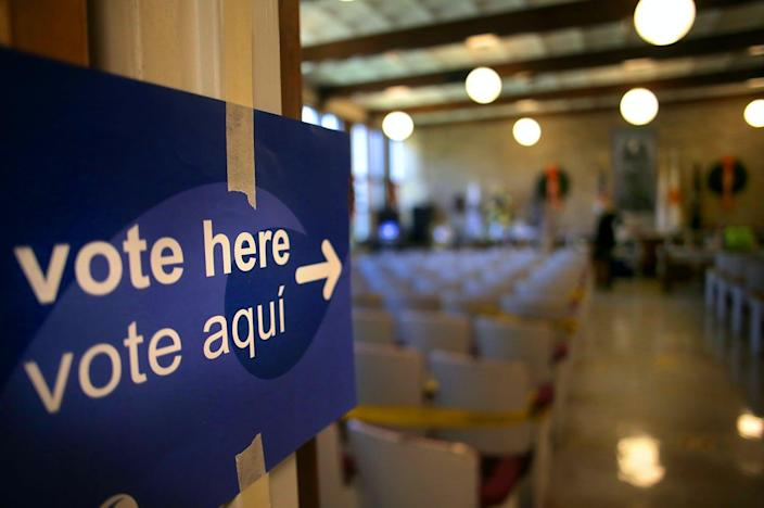 """<span class=""""caption"""">Voting is well underway in many states. Here, an early voting station in Lincoln, R.I., Oct. 13, 2020. </span> <span class=""""attribution""""><a class=""""link rapid-noclick-resp"""" href=""""https://www.gettyimages.com/detail/news-photo/voters-were-directed-to-cast-ballots-inside-at-lincoln-town-news-photo/1229111881?adppopup=true"""" rel=""""nofollow noopener"""" target=""""_blank"""" data-ylk=""""slk:Lane Turner/The Boston Globe via Getty Images"""">Lane Turner/The Boston Globe via Getty Images</a></span>"""
