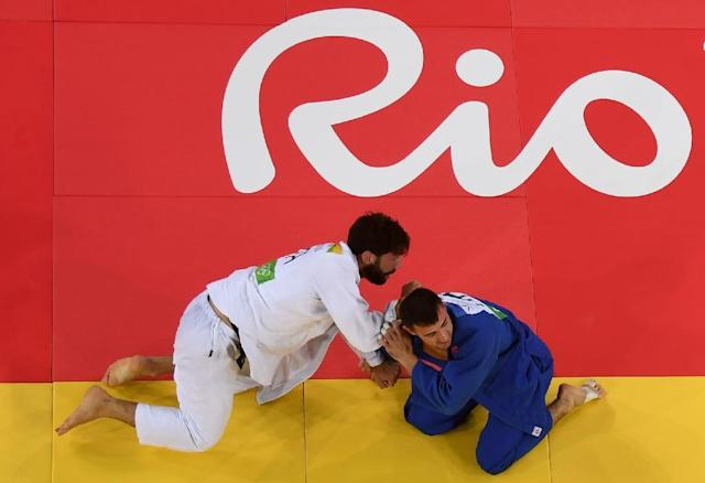 An overview shows Italy's Matteo Marconcini (white) competing with United Arab Emirates's Sergiu Toma during their men's -81kg judo contest bronze medal A match of the Rio 2016 Olympic Games in Rio de Janeiro on August 9, 2016 (AFP Photo/Eric Baradat)