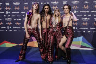 Members of the band Maneskin from Italy Thomas Raggi, from left, Ethan Torchio, Victoria De Angelis and Damiano David pose for photographers with the trophy after winning the Grand Final of the Eurovision Song Contest at Ahoy arena in Rotterdam, Netherlands, Saturday, May 22, 2021. (AP Photo/Peter Dejong)