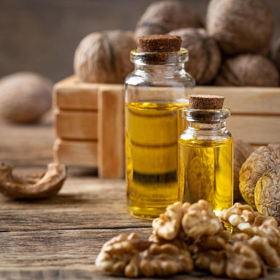 """<p>""""The very thing that make walnuts such a nutrient powerhouse as the only nut with an <strong>excellent source of plant omega-3s</strong> (ALA) make it's oil an excellent finishing ingredient to drizzle and pour on completed dishes,"""" says Wendy Bazilian, DrPH, RDN, Author of <a href=""""https://www.amazon.com/Eat-Clean-Stay-Lean-Weight/dp/1623367891"""" rel=""""nofollow noopener"""" target=""""_blank"""" data-ylk=""""slk:Eat Clean, Stay Lean"""" class=""""link rapid-noclick-resp"""">Eat Clean, Stay Lean</a> and owner of <a href=""""http://www.wendybazilian.com/private_practice.html"""" rel=""""nofollow noopener"""" target=""""_blank"""" data-ylk=""""slk:Bazilian's Health"""" class=""""link rapid-noclick-resp"""">Bazilian's Health</a> in San Diego. Since most walnut oil is sold unrefined or semi-refined, it has more of the naturally occurring nutrients and phytochemicals but this makes it more challenging when it comes to putting it over heat. </p><p>Bazilian suggests using walnut oil to toss into pasta dishes and drizzle over salad or a squash-based soup as a finisher. Since walnut oil is fairly pricey and delicate, Bazilian says it's best to store in the refrigerator or freezer to preserve the flavor and phytochemicals. </p><p><strong>Best for: </strong>Salad Dressings and drizzling</p><p><strong>Smoke point:</strong> 320°F</p><p><strong>Nutritionist pick:</strong> <a href=""""https://go.redirectingat.com?id=74968X1596630&url=https%3A%2F%2Fwww.instacart.com%2Fproducts%2F29926-spectrum-walnut-oil-16-fl-oz&sref=https%3A%2F%2Fwww.goodhousekeeping.com%2Fhealth%2Fdiet-nutrition%2Fg32108013%2Fhealthiest-cooking-oils%2F"""" rel=""""nofollow noopener"""" target=""""_blank"""" data-ylk=""""slk:Spectrum Essentials Walnut Oil"""" class=""""link rapid-noclick-resp"""">Spectrum Essentials Walnut Oil</a></p>"""