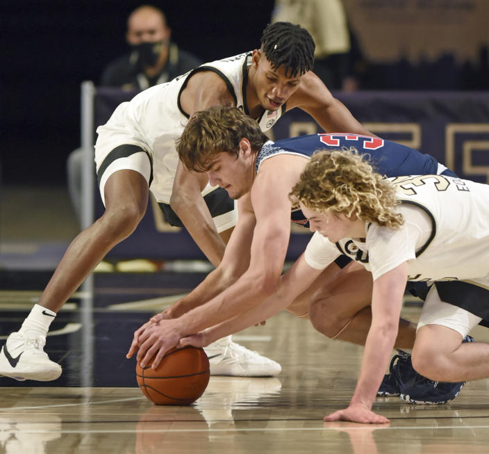 Wake Forest's Carter Whitt, right, and Ody Oguama, top, battle for the ball with Catawba's Ben Bowen during an NCAA college basketball game, Thursday, Dec. 31, 2020, at Joel Coliseum in Winston-Salem, N.C. (Walt Unks//The Winston-Salem Journal via AP)