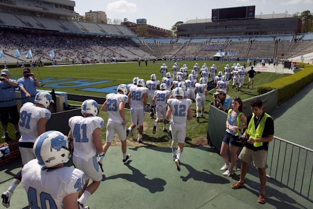 The white team enters Kenan Stadium for North Carolina's NCAA college football spring practice, Saturday, April 12, 2014, in Chapel Hill, N.C. (AP Photo/The News & Observer, Robert Willett)